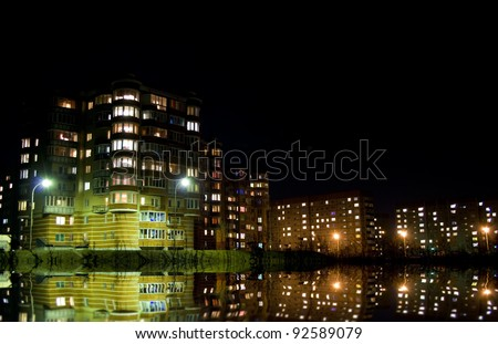 Burning lanterns and windows of a night city