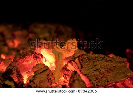 Burning logs of firewood before falling into smithereens.