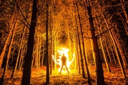 Burning man in the forest. Freezelight
