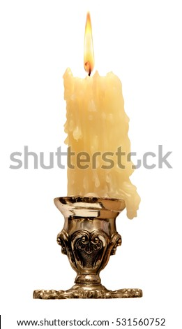 burning old candle vintage bronze Silver candlestick. Isolated On White Background. #531560752