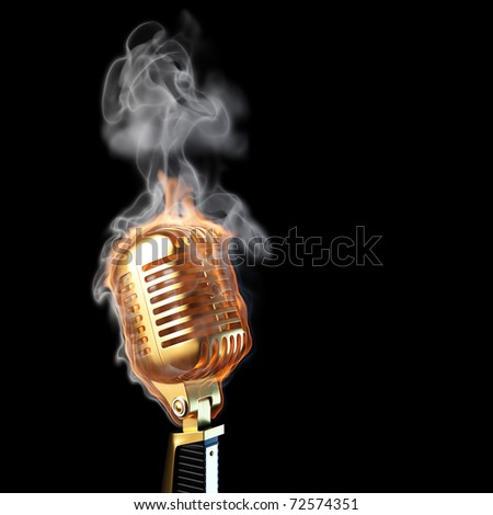 burning old golden microphone. isolated on black.