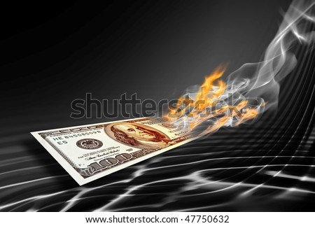 burning one hundred dollars banknote on abstract black background