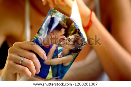 Burning photography kissing newlywed. Broken heart woman. Couple break up. Sad bride on unhappy wedding. Woman and groom quarrel. Girl burns in fire candle family pictures.