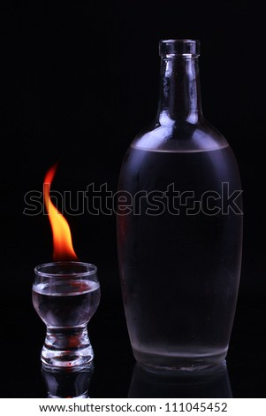 Burning pile of tequila and a bottle
