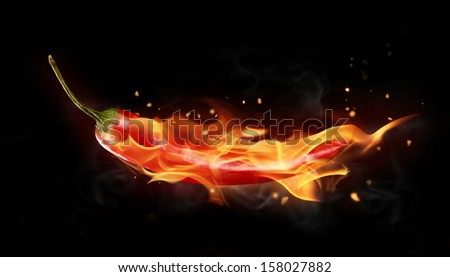 Burning red chilli pepper isolated on black background
