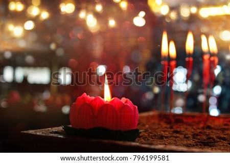 Burning red chinese candle in temple