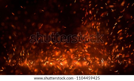 Burning red hot sparks fly from large fire in the night sky. Beautiful abstract background on the theme of fire, light and life. Burning embers glowing flying away particles over black background.