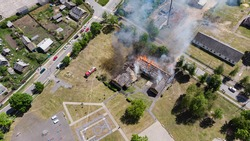 burning roof of a building taken from a quadrocopter