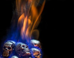 Burning skulls on black background