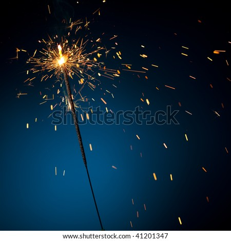 burning sparkler on blue