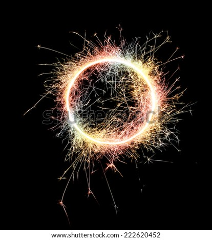Burning sparklers isolated on black background. Small fireworks giving off sparks of fire. Sparks explosion. High resolution.