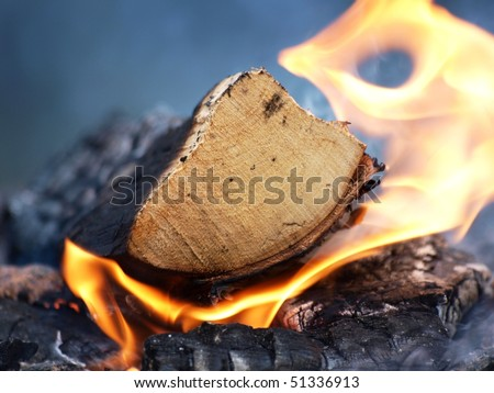Burning wood, flame and smoke on a bonfire