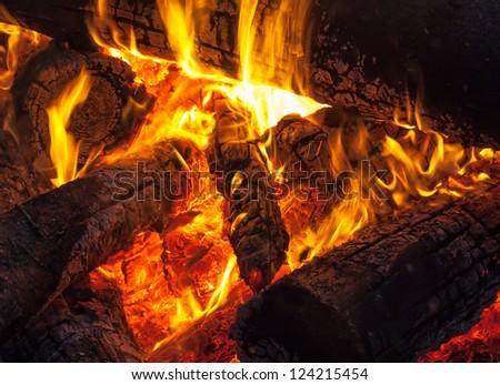 Burning wood on fireplace, campfire macro photo - stock photo
