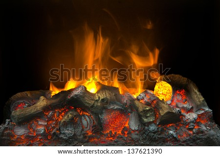 Burning wood on fireplace, campfire macro photo