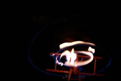 Burning wooden aircraft plane in darkness