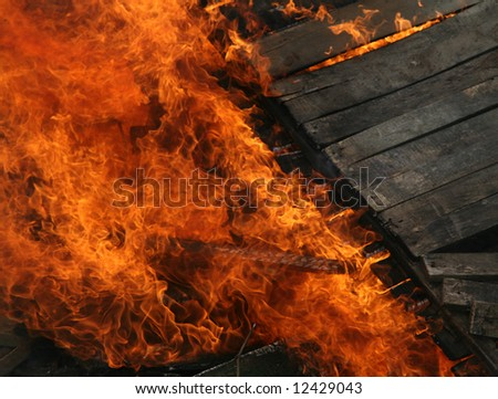 Burning wooden house. Close-up