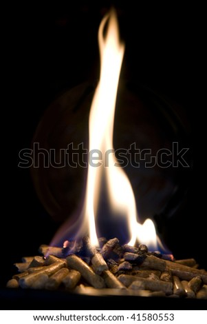 Burning woodpellets on black background