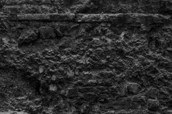 Burnt aged coarse gloomy city masonry (backdrop). Crumbled scary house cellar. Bumpy vintage facing castle fortress yard for 3D design. Hard dirty rural facade fortified tower, destroyed ground floor