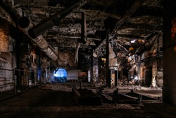 Burnt and ruined interior of industrial building after fire. Consequences of war, fire or other disaster