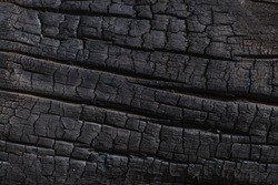 Burnt black wood background texture.