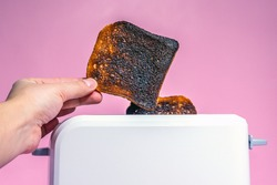 burnt bread toast in the toaster