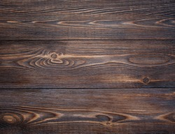 Burnt brown not painted wooden board texture background. Abstract wooden retro texture. Top view