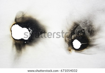 Burnt cardboard on a white background #671054032