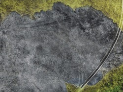 Burnt ground and grass - top view