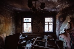 Burnt old rural house interior. Consequences of fire.