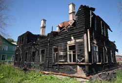Burnt old wooden building in Russia