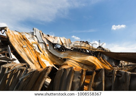 Burnt out Factory with charred roof trusses After Fire in Perfume Factory #1008558367