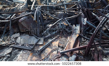 Burnt out Factory with charred roof trusses After Fire in Perfume Factory #1022657308
