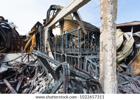 Burnt out Factory with charred roof trusses After Fire in Perfume Factory #1022657311