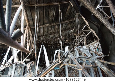 Burnt out Factory with charred roof trusses After Fire in Perfume Factory #1099623446