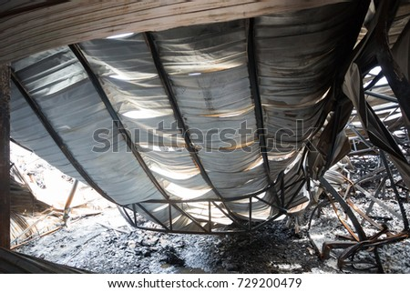 Burnt out Factory with charred roof trusses After Fire in Perfume factory  #729200479