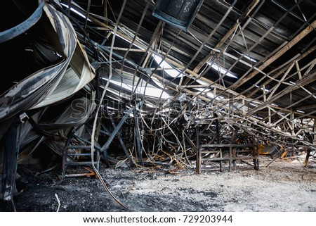 Burnt out Factory with charred roof trusses After Fire in  Perfume Factory #729203944