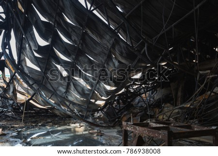 Burnt out Factory with charred roof trusses After Fire in Perfume Factory #786938008