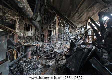 Burnt out Factory with charred roof trusses After Fire in Perfume Factory / Burnt interiors of factory after fire.  #783440827