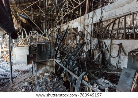 Burnt out Factory with charred roof trusses After Fire in Perfume Factory / Burnt interiors of factory after fire. #783945157
