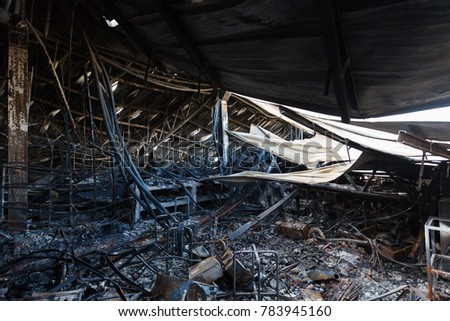 Burnt out Factory with charred roof trusses After Fire in Perfume Factory / Burnt interiors of factory after fire. #783945160