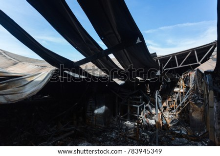 Burnt out Factory with charred roof trusses After Fire in Perfume Factory / Burnt interiors of factory after fire. #783945349