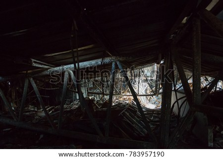 Burnt out Factory with charred roof trusses After Fire in Perfume Factory / Burnt interiors of factory after fire. #783957190