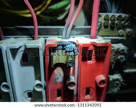 burnt out old fuse in electrical fuse box - danger - safety warning  #1311342092