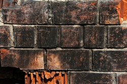 burnt red brick background sunny day
