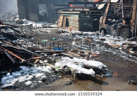 Burnt rubble of a warehouse fire