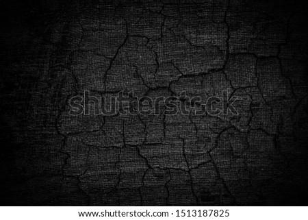 Burnt wooden Board texture. Burned scratched hardwood surface. Halloween backdrop. Smoking wood plank halloween background.  stock photo