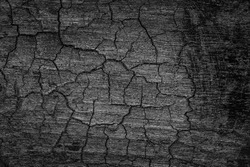 Burnt wooden Board texture. Burned scratched hardwood surface. Smoking wood plank background