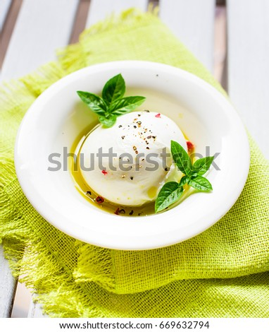 Burrata Cheese with Olive Oil and Fresh Basil  #669632794