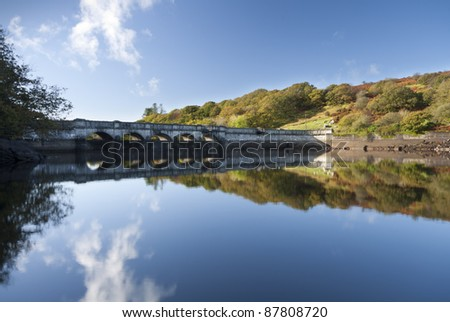 Burrator Dam, together with Sheepstor Dam which lies just to the east, impounds Burrator Reservoir 13km north east of the city of Plymouth. Work began on 9th August 1893 and was completed in 1898.