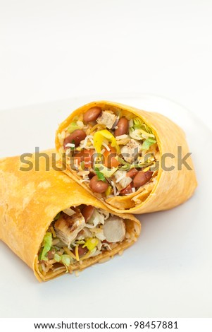 Burritos with chicken on a white plate